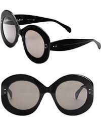 Alaïa - Women's Enhanced Femininity Black & Gray Round Sunglasses - Black - Lyst