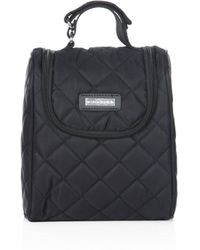 Storksak - Quilted Bottle Bag - Lyst