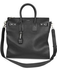 3043dcc3c69b8 Lyst - Saint Laurent Classic Toile Monogram Duffle 24 Bag In Black ...