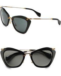 c350ed38389a Miu Miu Matte Cat Eye Sunglasses in Black - Lyst