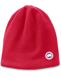 6d96af95fe1 Lyst - Canada Goose Pompom-embellished Wool Beanie Hat in Red