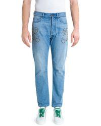 Versace - Studded Light Wash Denim Jeans - Lyst