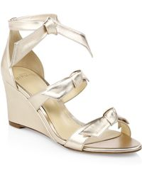 1492c05a648 Lyst - Alexandre Birman Vicky Python Wedge Sandals in Natural