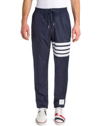 Thom Browne | Striped Nylon Zip-up Pants | Lyst