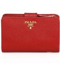 2a7f5ab5d0f9 Prada - Women s Medium Saffiano Leather Tab Wallet - Fuoco - Lyst