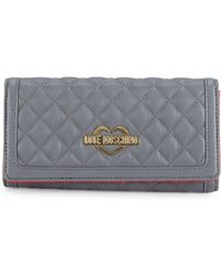 5e9c549351d Love Moschino Logo Embossed Wallet in Red - Lyst