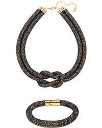 Swarovski - Black Stardust Necklace And Bracelet Set - Lyst