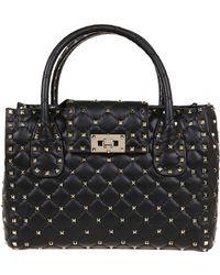 5883e52cf Valentino Rockstud Black Patent Leather Tote in Black - Lyst