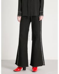 Mo&co. - Crystal-embellished Flared High-rise Jeans - Lyst