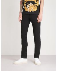 Versace - Leopard-print Pockets Regular-fit Straight Jeans - Lyst