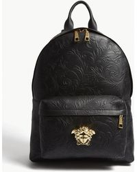 Versace - Black And Gold Medusa Patterned Leather Backpack - Lyst