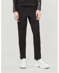 Maje - With Love Striped Stretch-jersey Pants - Lyst