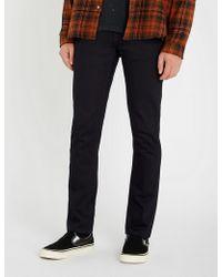 Nudie Jeans - Grim Tim slim-fit tapered jeans - Lyst