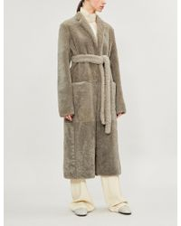 The Row - Muto Belted Shearling Coat - Lyst
