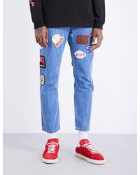 Gcds - Regular-fit Cropped Knitted-patch Jeans - Lyst