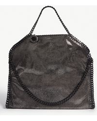 098378e27dcf Stella McCartney - Ruthenium Black Disk Charm Falabella Metallic Faux  Leather Shoulder Bag - Lyst