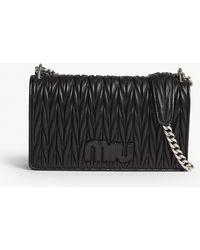 Miu Miu - Miu Black Quilted Logo Matelassé Leather Shoulder Bag - Lyst