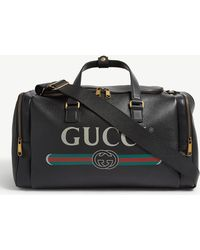 Gucci - Logo Print Grained Leather Holdall - Lyst