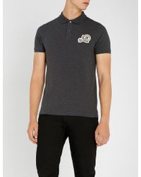 moncler smiley face polo black