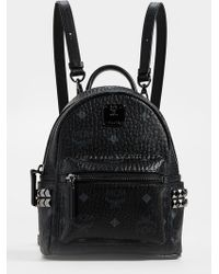 MCM - Baby Stark Studded Coated Canvas Backpack - Lyst