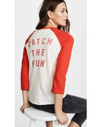 AMO - Catch The Fun Raglan Tee - Lyst