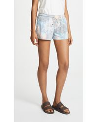 Sol Angeles - Aqua Flora Flounce Shorts - Lyst