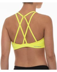 c9d9aa4acc Lyst - New Balance Wb81031 Studio Sports Bra in Yellow