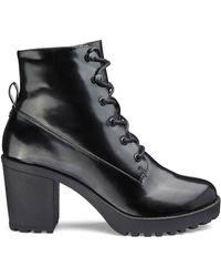 3049cfcdb532 Lyst - Tory Burch Stormy Chelsea Rain Bootie in Black