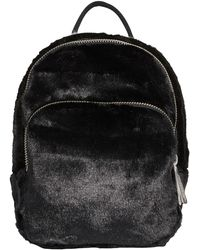 7199d15bbe Lyst - adidas Originals Mini Izzy Backpack in Black