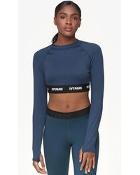 39ace2aead254f Ivy Park - Logo Tape Long Sleeve Crop Top - Lyst
