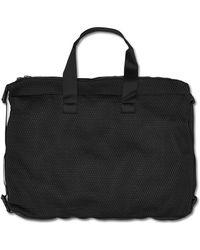 PUMA - Stampd X Duffle Bag - Lyst