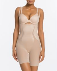 a33ca402e78ff Lyst - Spanx Haute Contour Open-bust Mid-thigh Bodysuit in Pink