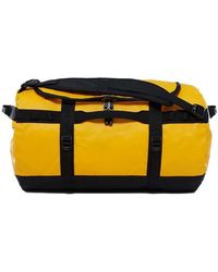 The North Face - Base Camp Duffle Small Women's Travel Bag In Gold - Lyst