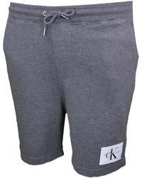 Calvin Klein - Short molleton gris pour homme hommes Short en Gris - Lyst