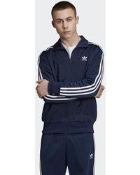 090dd081a8 adidas - Veste de survêtement Firebird hommes Veste en bleu - Lyst