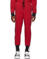 Miharayasuhiro - Pantalon de survetement rouge Side Stripe - Lyst