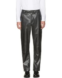 Telfar - Black Coated Denim Trousers - Lyst