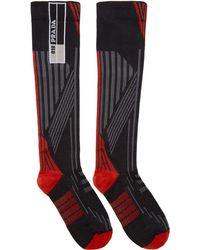 Prada - Red And Black Logo Socks - Lyst