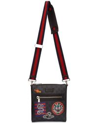 987ac7244bdaa7 Gucci Night Courrier Leather-trimmed Appliquéd Monogrammed Coated ...