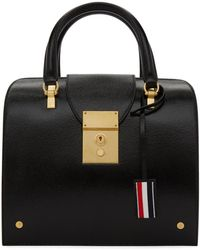 f11af2bfea8 Thom Browne Black Patent Leather Trigger Reef Fish Duffle Bag in ...