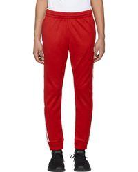 lyst adidas originali rosso dei pantaloni della tuta in rosso per gli uomini.