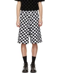 McQ - Black And White Racing Check Swallow Low Shorts - Lyst