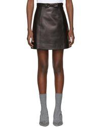Miu Miu - Black Leather A-line Pockets And Bow Miniskirt - Lyst