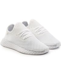Adidas Originals deerupt Runner zapatillas negro en negro para hombres Lyst