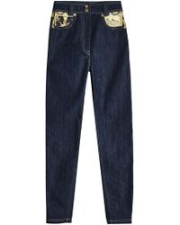 Versace - Skinny Denim With Printed Pockets - Lyst