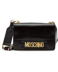 Lyst - Sac porté épaule en cuir verni à logo Moschino en coloris Noir e1f3a615749