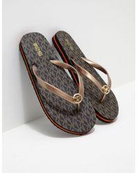 a824e7d13637 Lyst - Women s Michael Kors Flip-flops Online Sale