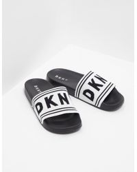 04f0f999175 Lyst - DKNY Madi Classic Flip Flop Sandals in White