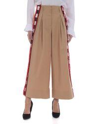 Stella Jean - Pantalone palazzo beige con bande a righe - Lyst