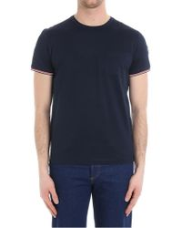 Moncler - T-shirt in piquè con taschino blu - Lyst